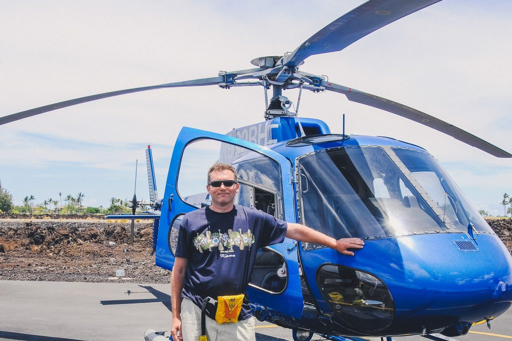 man standing next to helicopter in Hawaii