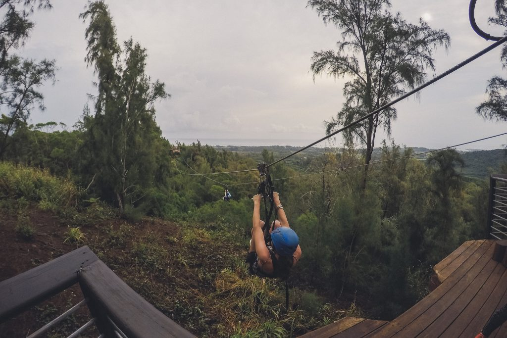 Climb Works in Hawaii, girl ziplines down the course