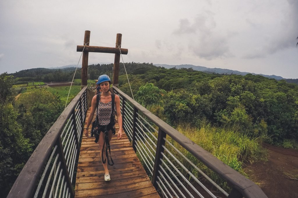 Climb Works in Oahu, girl walks down bridge