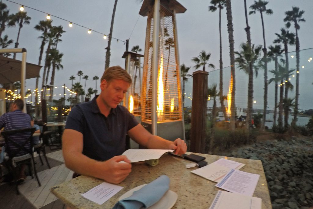 Man looking at menu at Tidal restaurant in San Diego