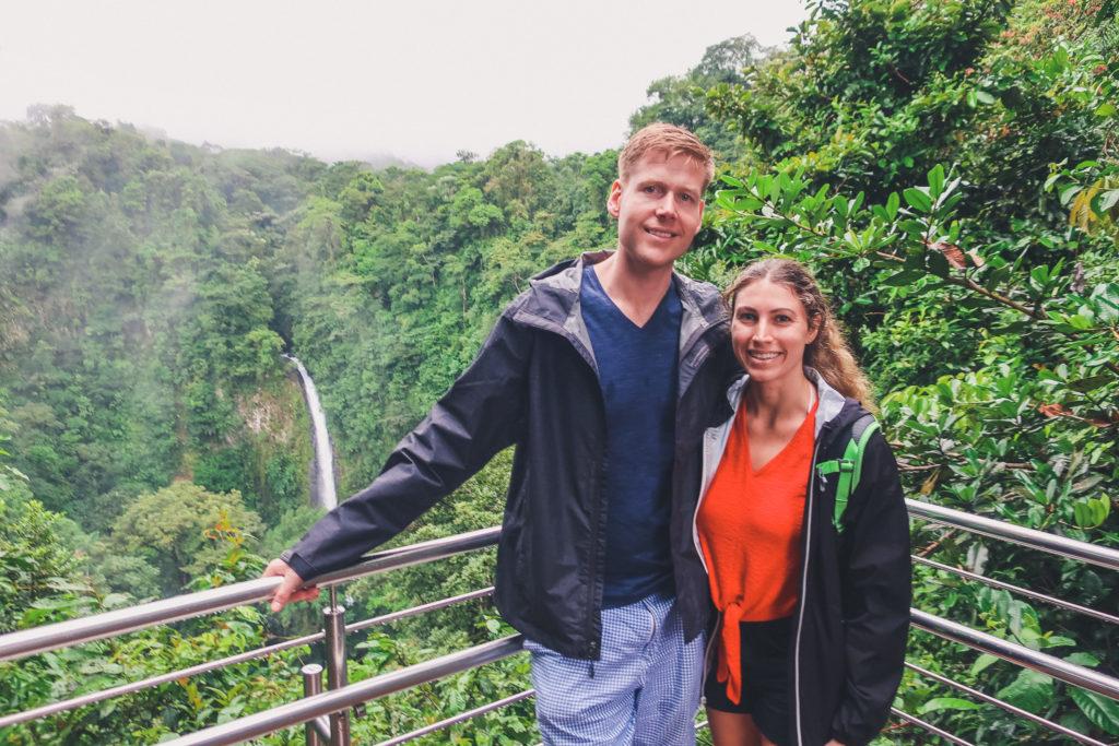 couple in Costa Rica, near waterfall