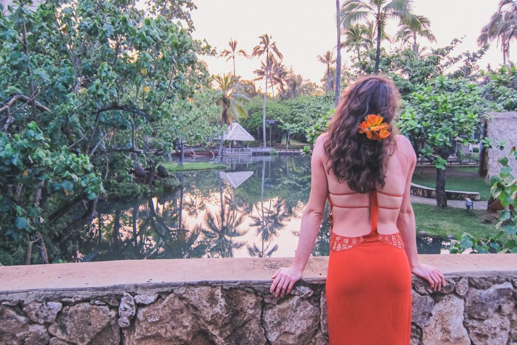 woman at Polynesian Cultural Center around sunset