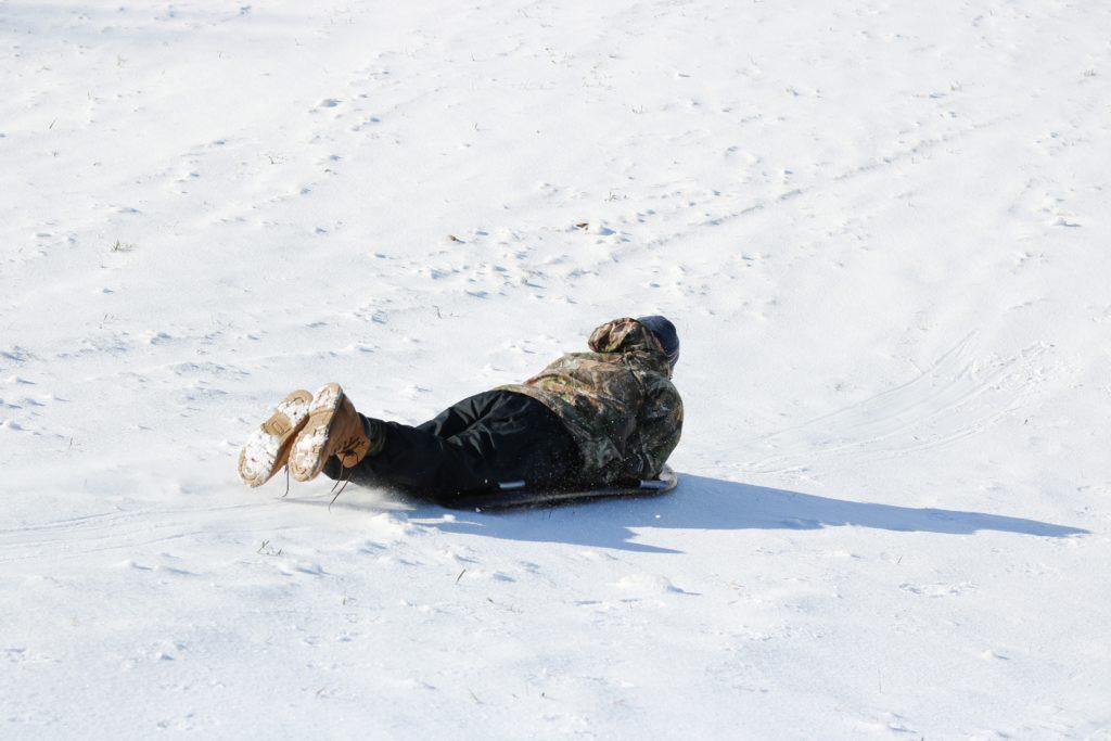 man sledding