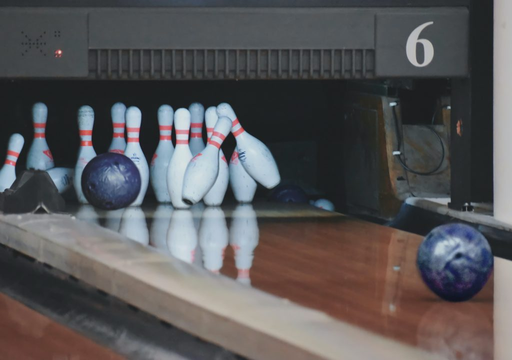 bowling pins being hit by bowling ball