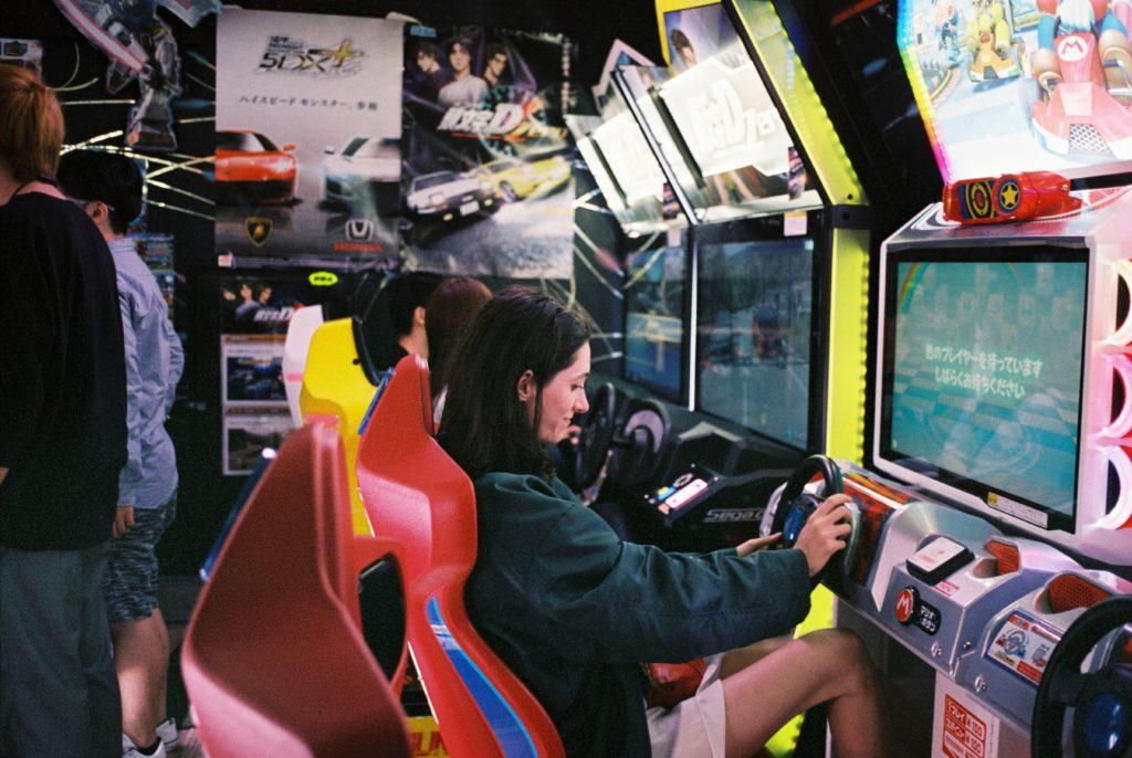 woman plays arcade games
