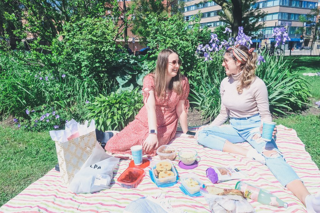 two women have picnic in Chicago at Oz Park