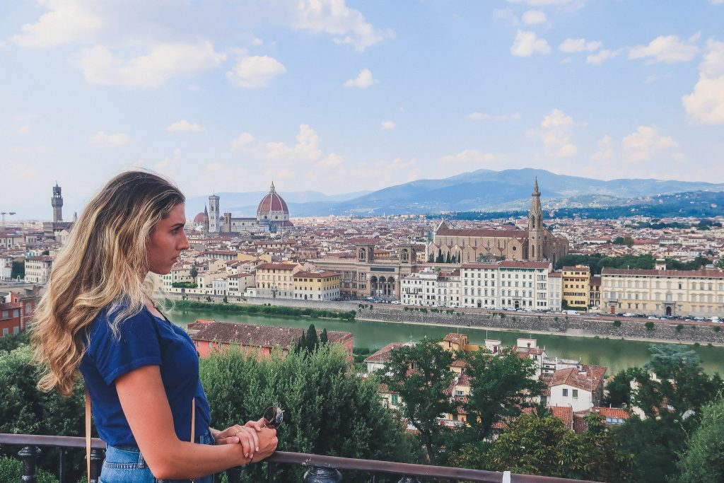 girl looking off in the distance in front of Tuscany, from Michelangelo Square