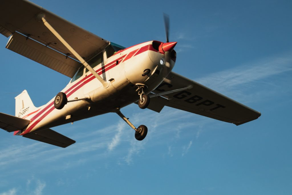 small plane flying over blue sky