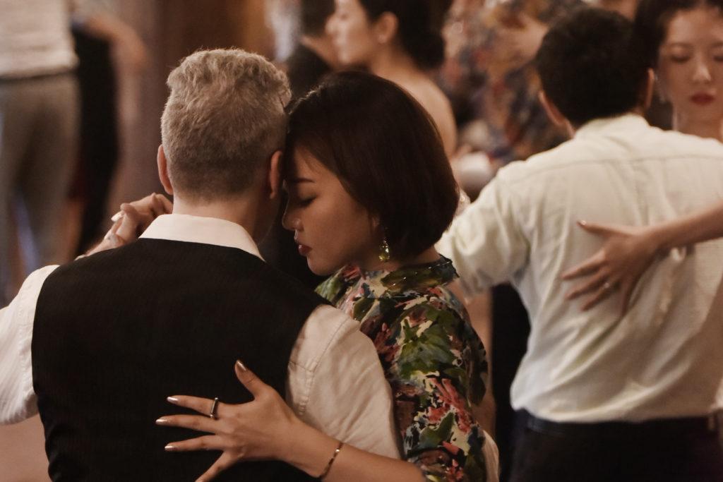 couple dances intimately