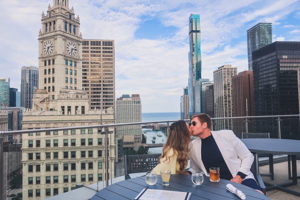 Couple kisses at Chicago Rooftop bar