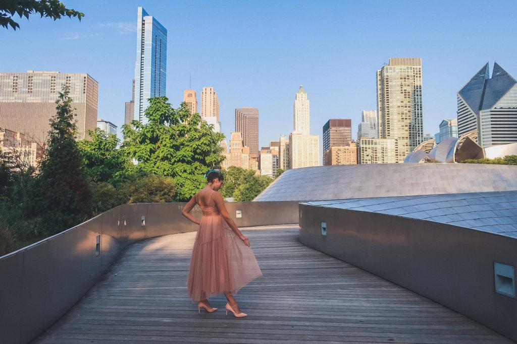 view from BP Pedestrian bridge, woman walks in pink gown
