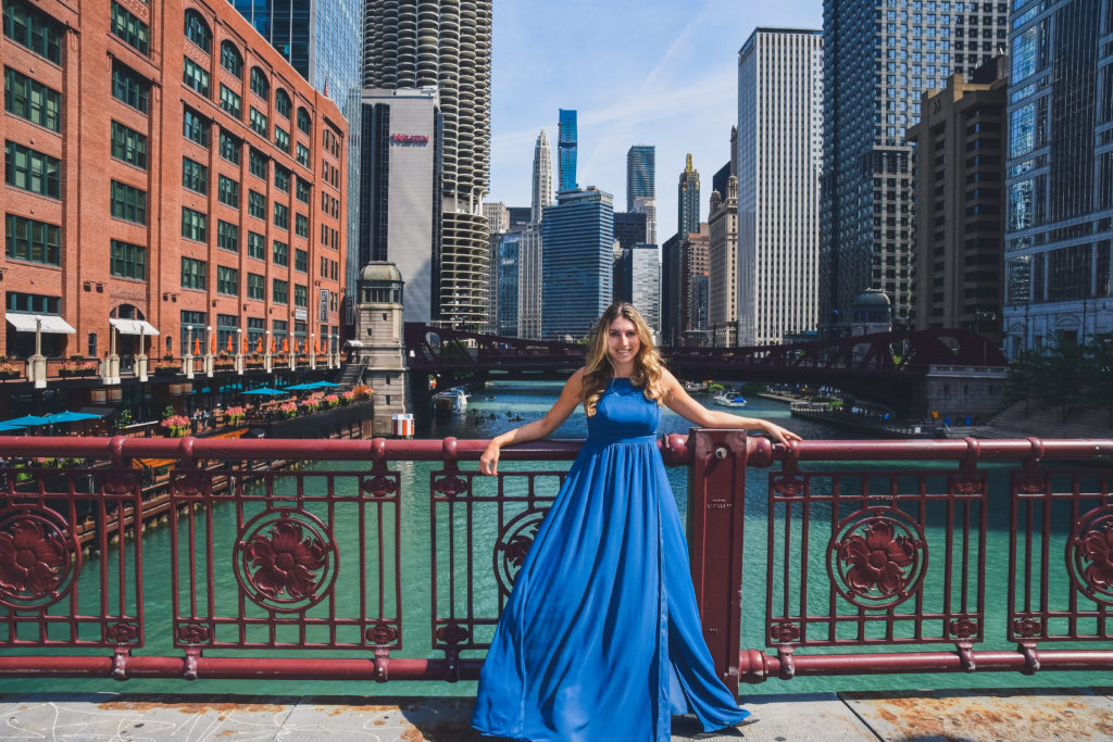 Woman wears flowy gown near Chicago's Loop facing the Chicago River