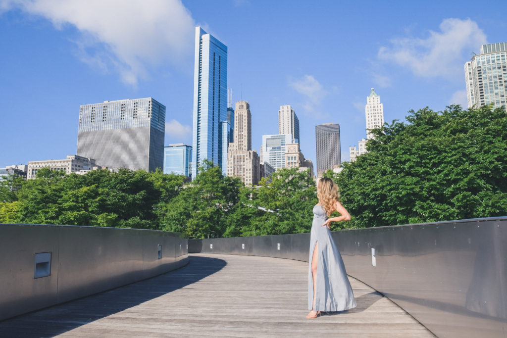 woman walks on BP Pedestrian Bridge in long gown