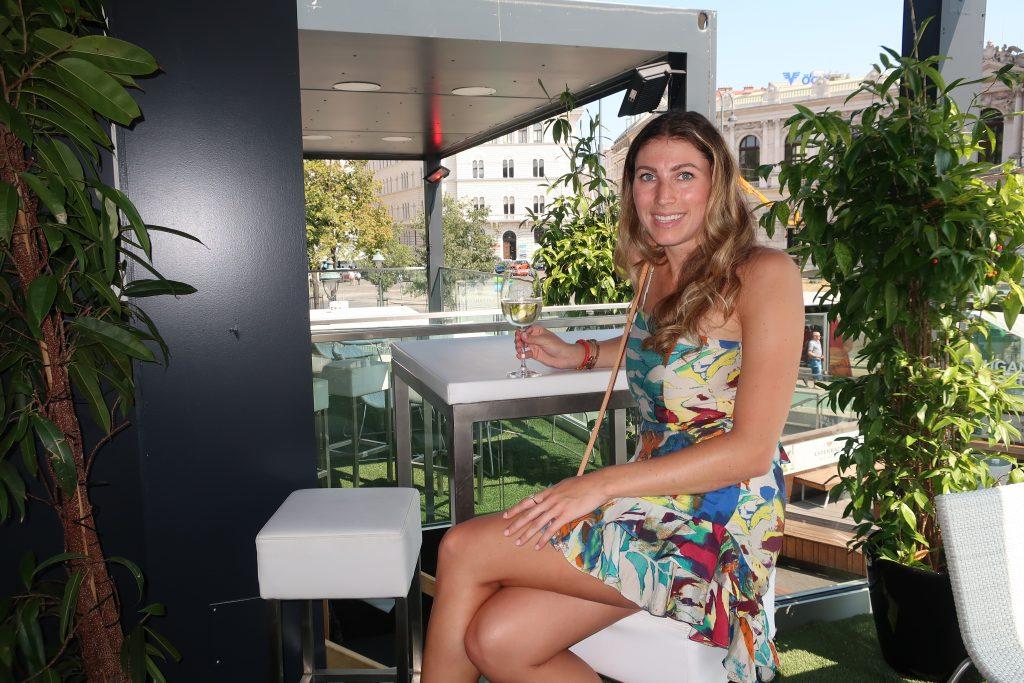girl drinks wine in Vienna