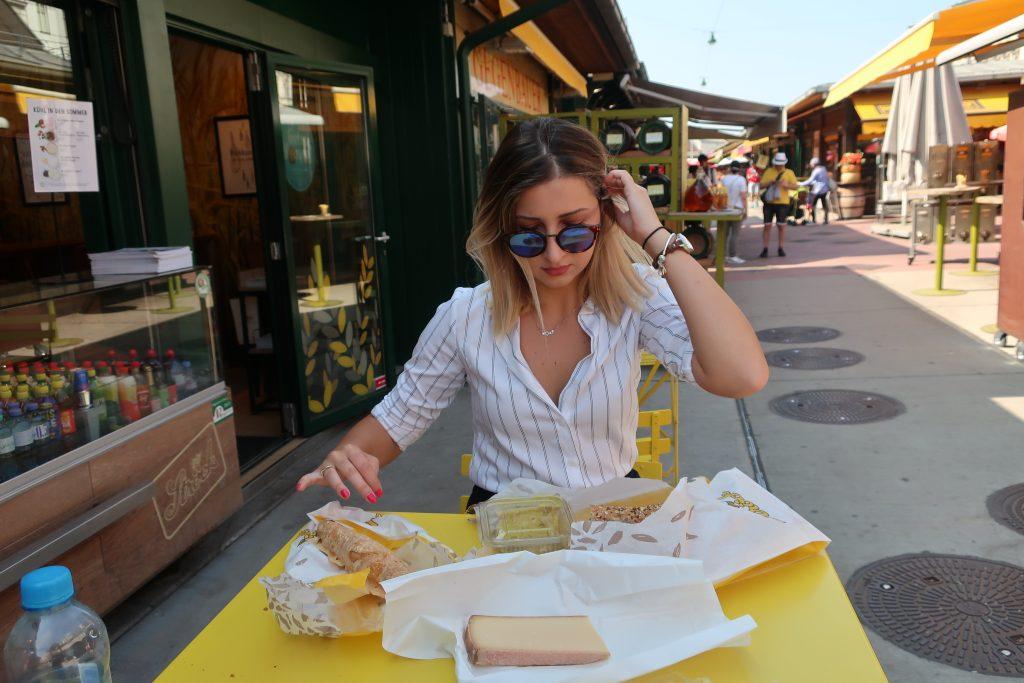 woman eats food at Nashmarket in Vienna