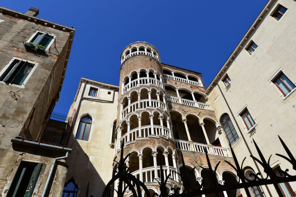 Beautiful renaissance spiral staircase in the center of Venice, one of the most famous tourist attraction in the city, seen from below