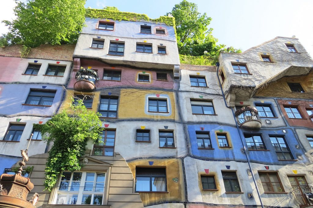Hundertwasser House, colorful apartments with trees growing out of windows