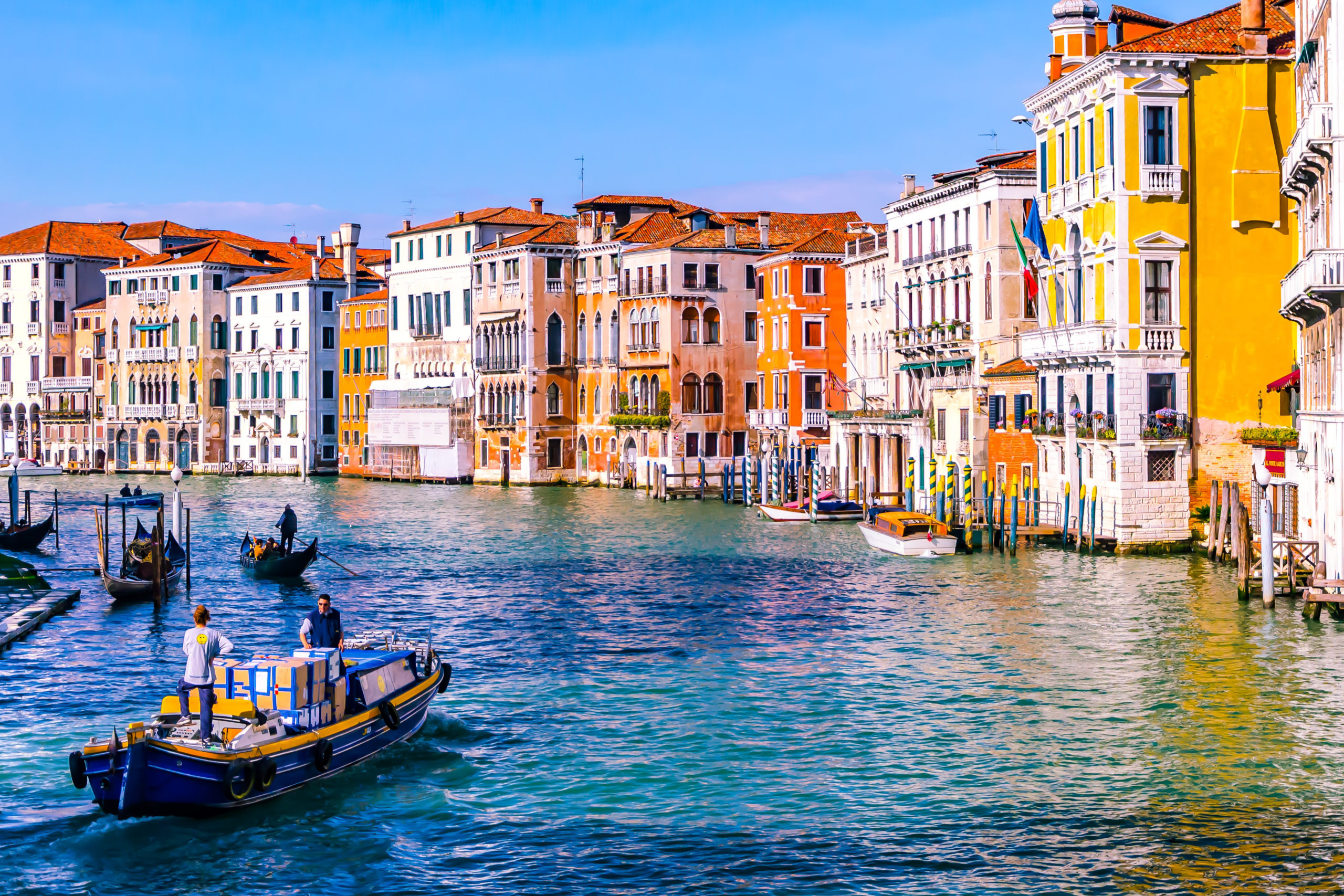 colorful photo of Venice from a canal