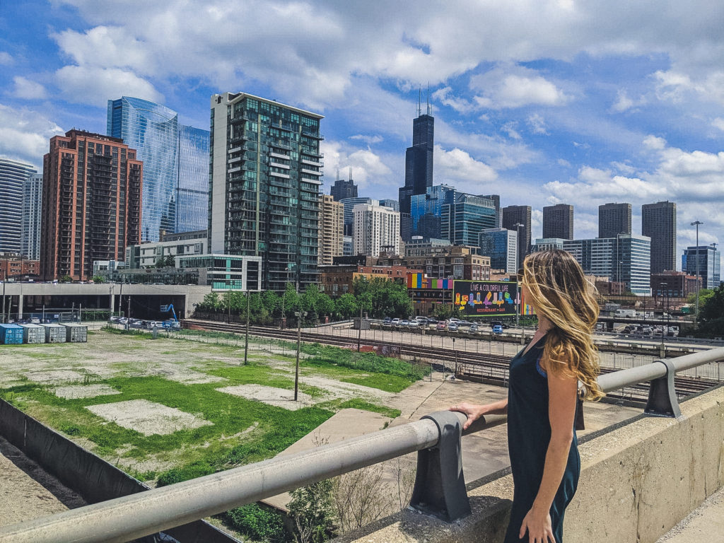 woman looks out at Chicago skyline