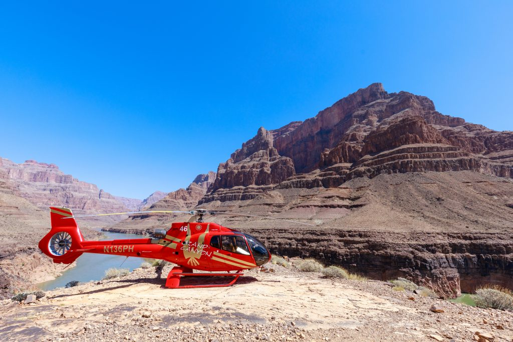 Scenic shot of a helicopter parked near the bottom of the Grand Canyon West Rim