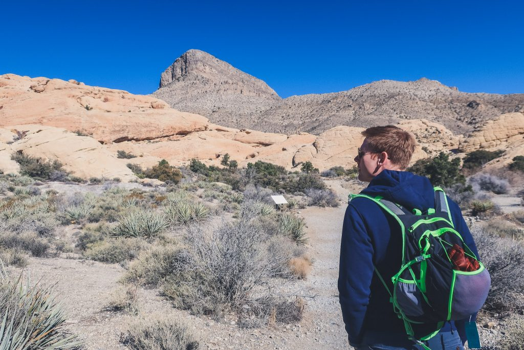 man hiking in Las Vegas desert at Red Rock State Park