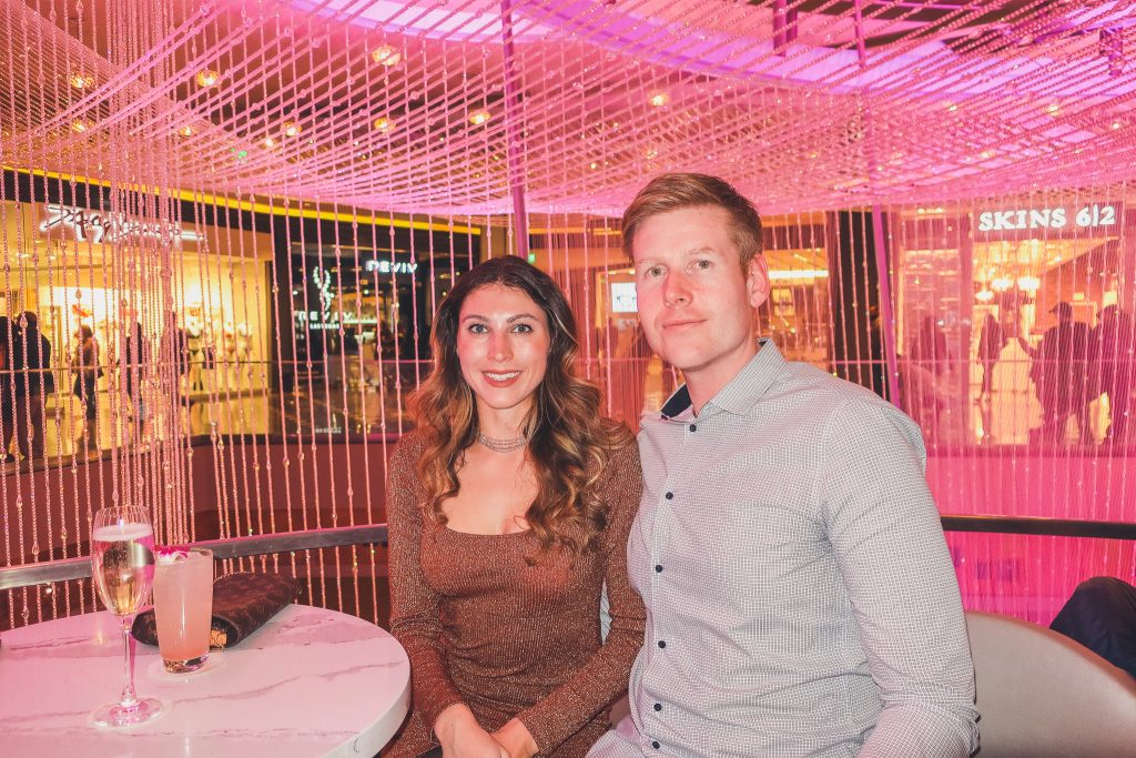 couple at Chandelier Bar at Cosmo Hotel in Las Vegas