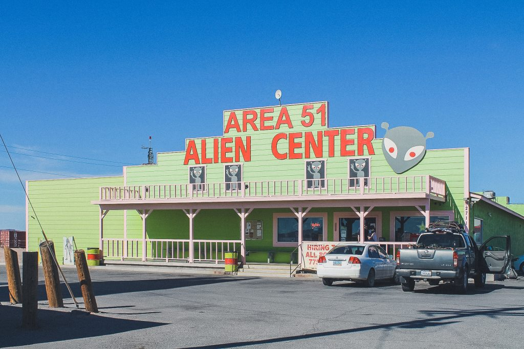"green building that reads ""area 51: alien center."""
