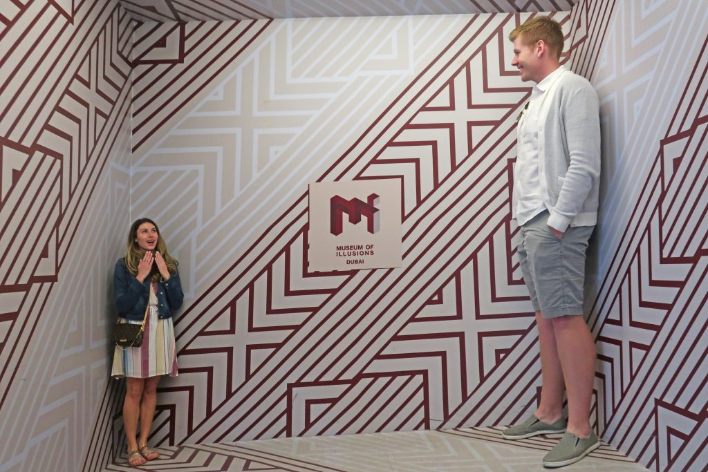 Interactive exhibit with 2 people at the Museum of Illusions in Dubai