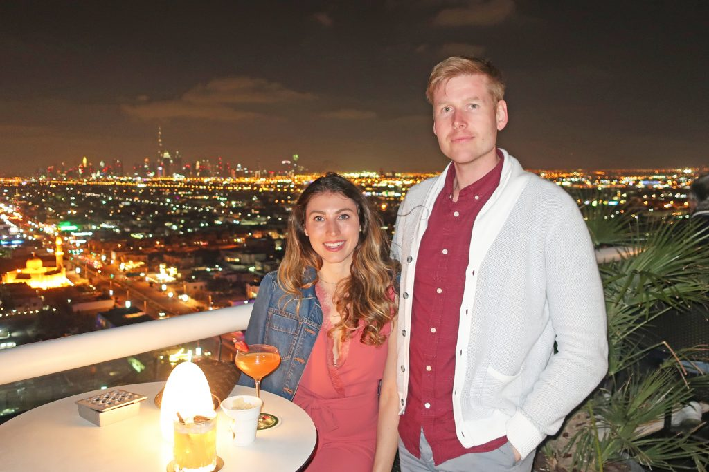 couple smiling at the camera from Uptown Bar in Dubai