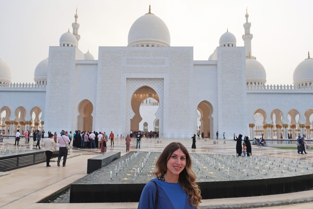 girl in front of grand mosque
