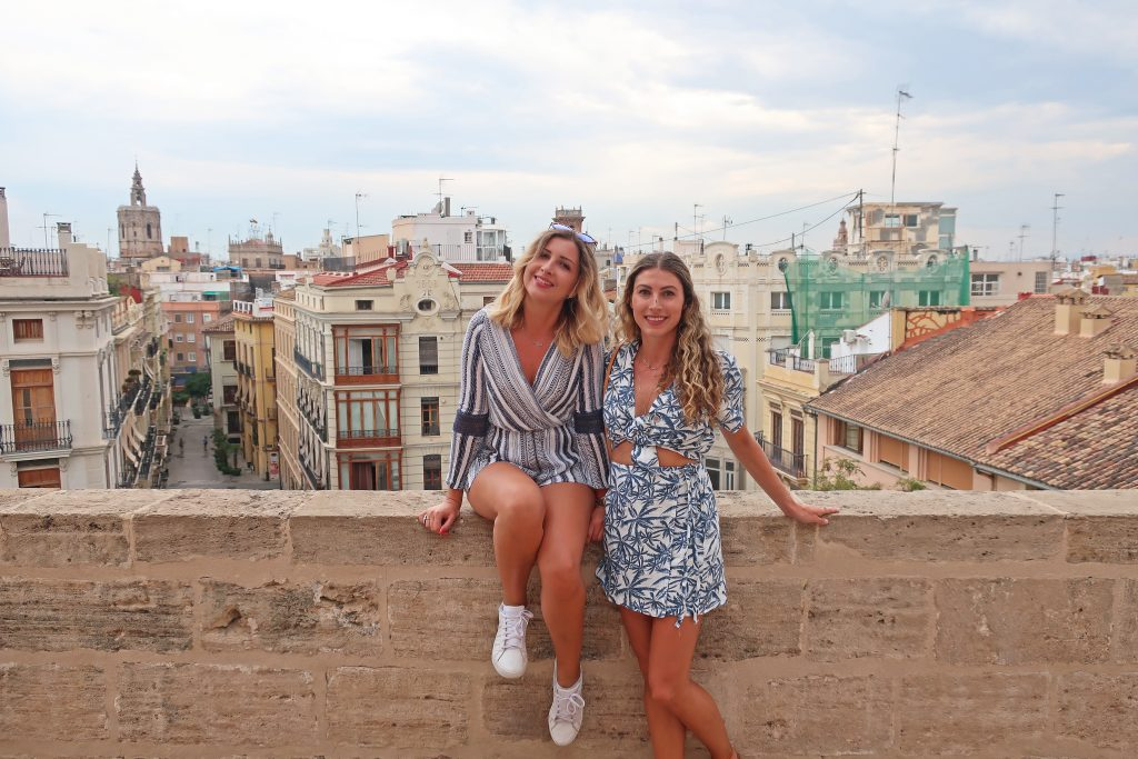 Two Girls standing in the Torres de Serranos, with Valencia City rooftops in the background