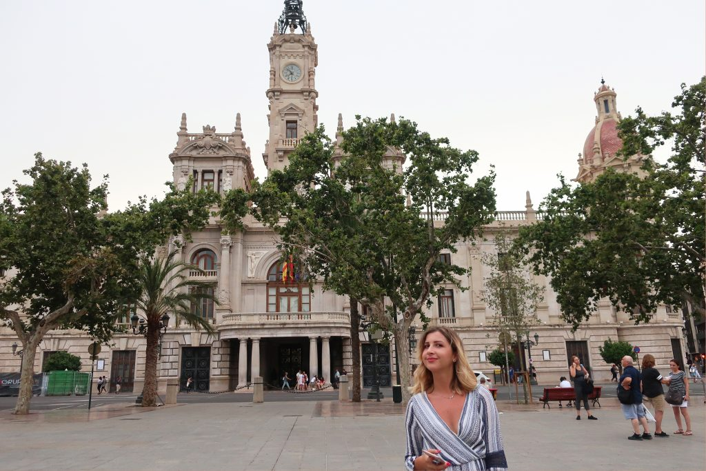 Girl standing in front of Valentina City Hall smiling