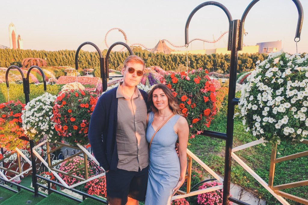 couple at Dubai Miracle Garden just before sunset