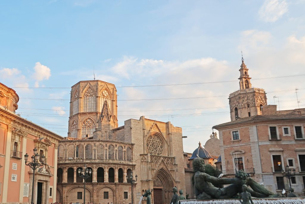 Plaza de la Virgen with part of the Turia Fountain in front and the Valencia Cathedral behindof the