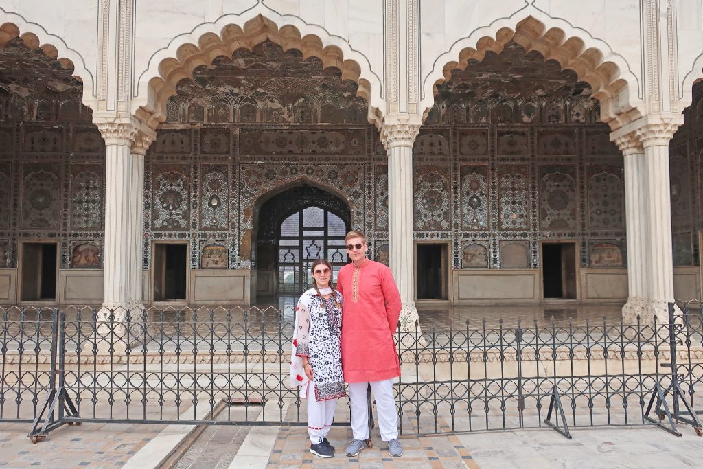Couple in front of the Sheesh Mahal at the Lahore Fort