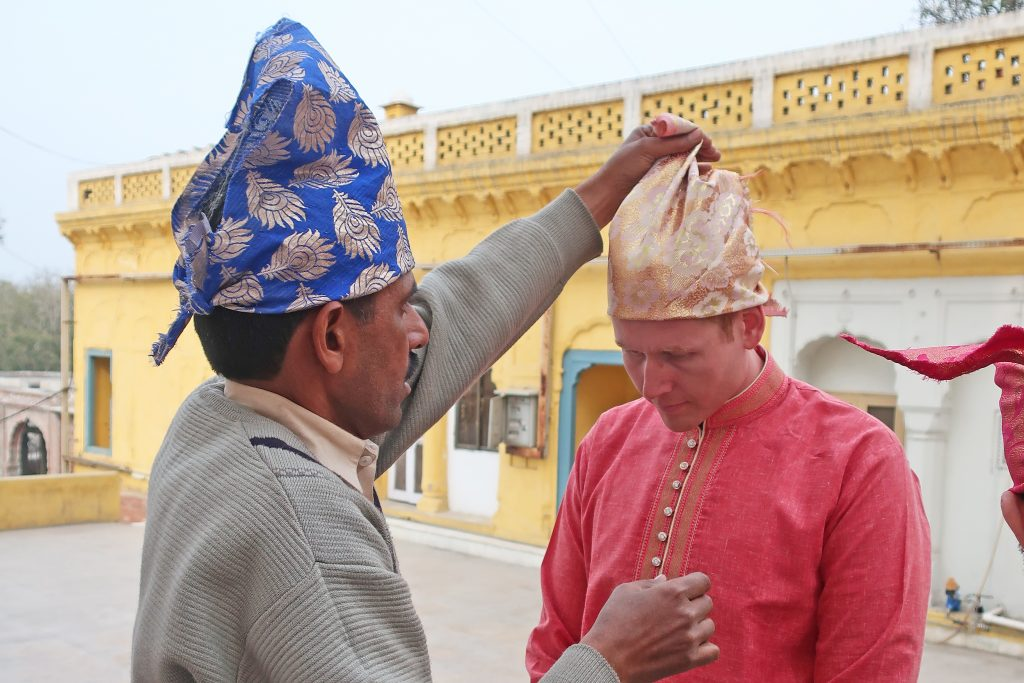 Men covering head before entering a Sikh temple
