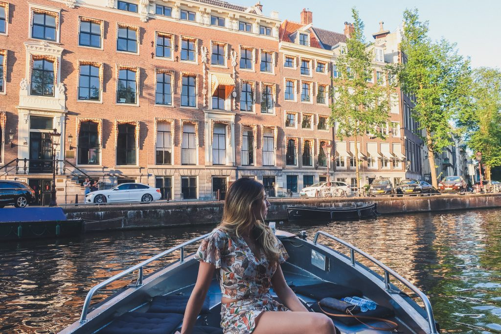 Girl on boat in Amsterdam's canals