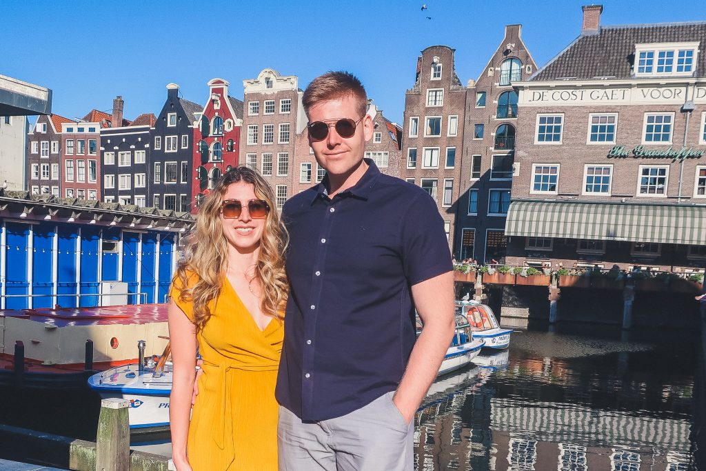 Couple in front of Amsterdam's most known Dancing Houses