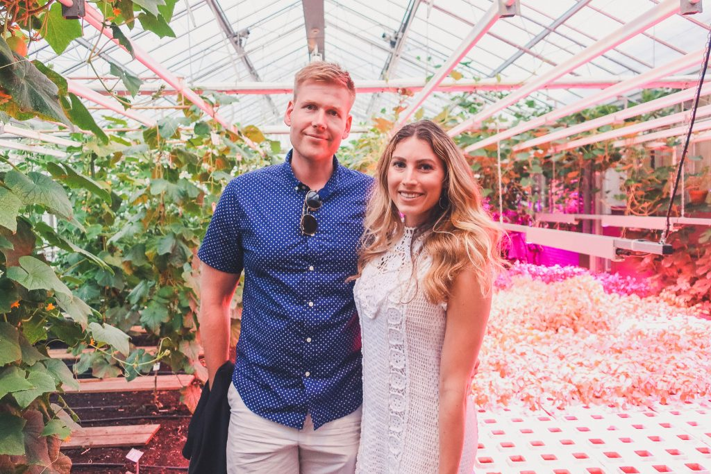 couple standing in the greenhouse of restaurant de kas in Amsterdam