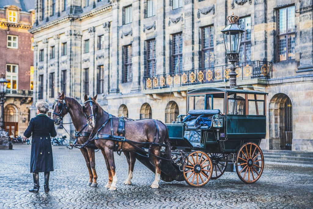 Carriage with horses on the central square of Amsterdam. on December 17, 2016 in Amsterdam - Netherlands.