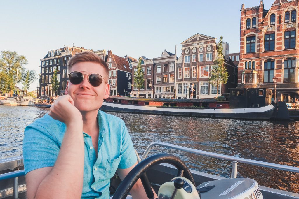 Boy on boat in Amsterdam Canals