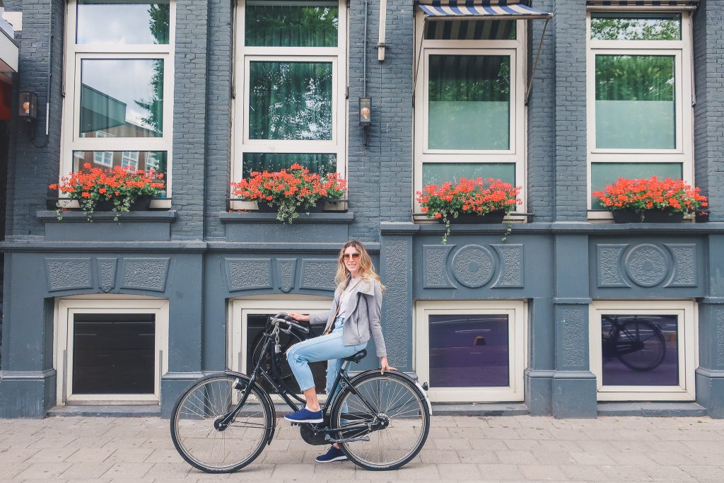 Girl riding a bike in Amsterdam