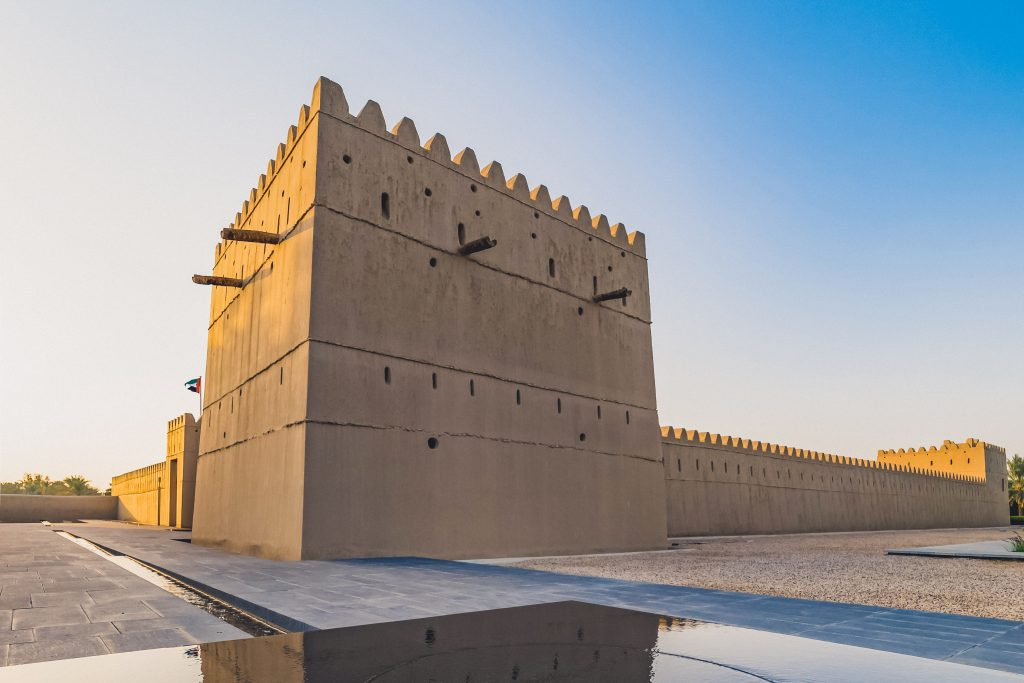 Qasr Al Muwaiji, Al Ain, United Arab Emirates - Jan.5, 2018: The Palace of His Highness Sheikh Khalifa bin Zayed Al Nahyan, President of the UAE – has been restored and reopened to the public as a museum and permanent exhibition. View of the Restored Defensive Tower and Modern Fountain
