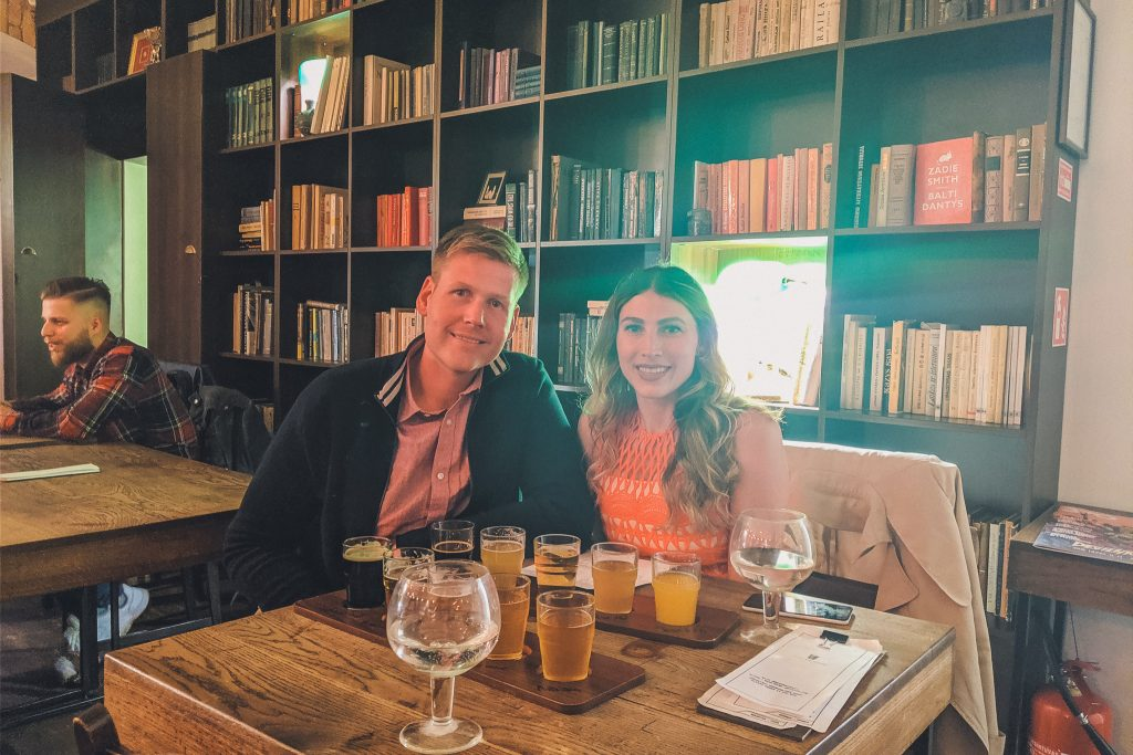 couple with flights at the beer library in Vilnius