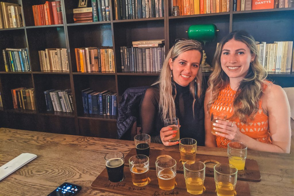 Two girls with flights at the Beer Library in Vilnius