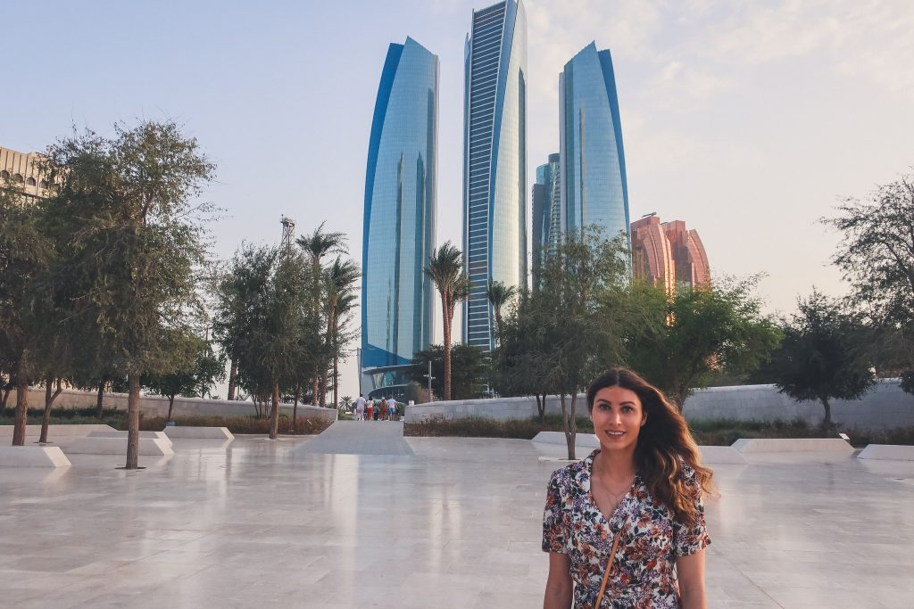 girl standing in front of etihad towers
