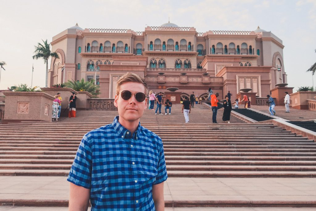 man standing in front of emirates palace