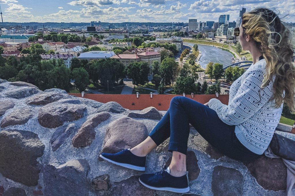 Girl looks out at vilnius from hill near Gediminas Castle