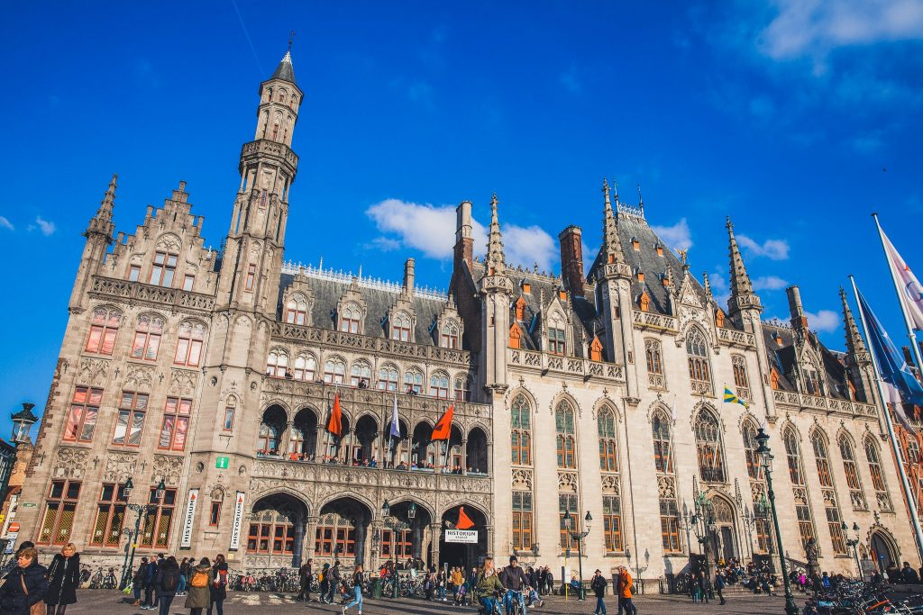 BRUGES, BELGIUM - MARCH, 2018: Provincial Court and Historium Bruges buildings on the market place