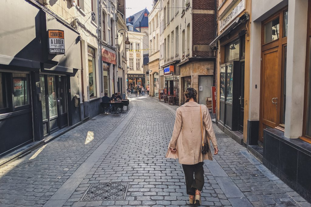 Girl walking through the streets of Brussels